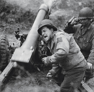 On the ground, artillerymen such as these firing a 105 mm M2A1 howitzer at Carentan, France, counted on the PCS's charts to account for the effects of range, elevation, muzzle velocity, weather, and other factors on the trajectory of their shells.