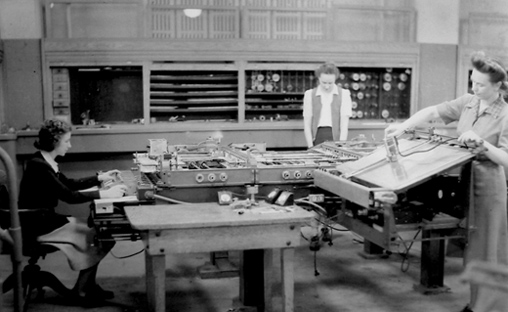 In addition to hand computing on paper, Kay McNulty, Alyse Snyder, and Sis Stump, above, operated a Bush differential analyzer machine, a mechanical calculating machine developed in the 1930s, which helped crunch the enormous amount of data that went into establishing range projections for a variety of different field artillery pieces.
