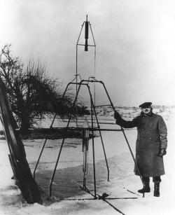 Dr. Robert H. Goddard and a liquid oxygen-gasoline rocket at Auburn, Massachusetts.